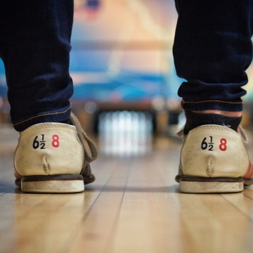 man with bowling shoes